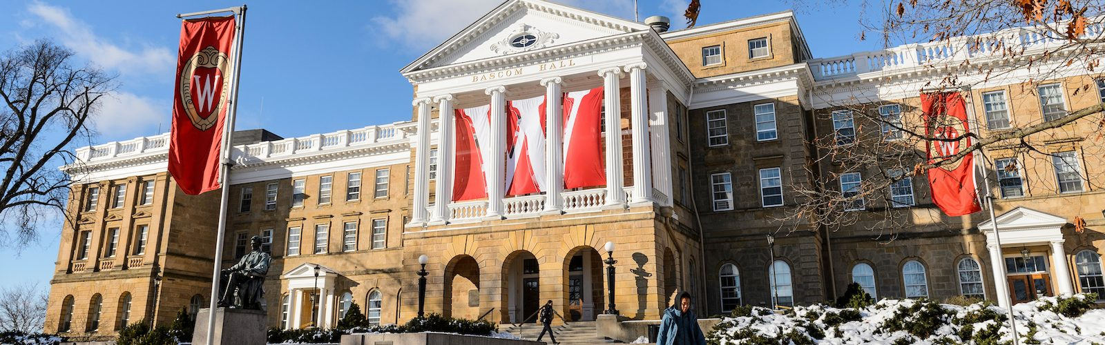 Bascom Hall with a large W banner behind the pillars